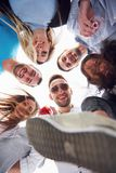 Summer vacation, happy people - a group of teenagers looking down with a happy smile on his face. Stock Photo