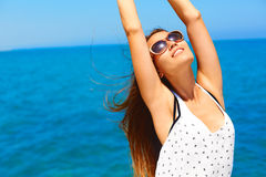 Summer vacation. Happy woman enjoying the sun. Royalty Free Stock Images