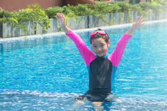 Happiness and smiling Asian cute little girl has feeling funny and enjoy in swimming pool. royalty free stock photography