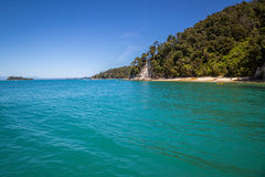 Summer vacation landscape with blue ocean and sandy beach, New Zealand Royalty Free Stock Photo
