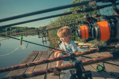 Summer vacation of little boy fishing. On river royalty free stock photos