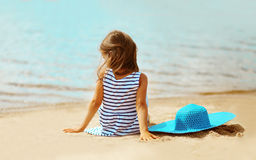 Summer vacation, lovely girl resting. On the beach near water Stock Photos