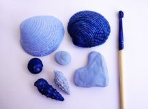 Summer vacation memories concept. Shells and pebbles painted in light and dark blue color and brush with blue color on it. Diy stu. Summer vacation memories stock images