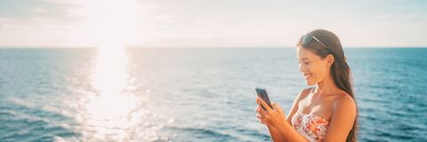 Free Summer Vacation Mobile Phone Tourist Asian Woman Using Smartphone On Holiday Beach Banner Panoramic. Royalty Free Stock Photo - 215389875