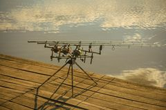 Summer vacation, pastime, hobby. Rods and reels at river or lake water. Fishing, adventure, sport, activity. Spin fishing, angling, catching fish. Spinning Stock Photography