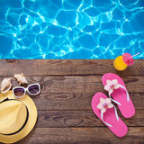 Summer vacation. Pink sandals by swimming pool Royalty Free Stock Photo