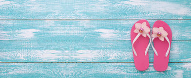 Summer vacation. Pink sandals by swimming pool Stock Image