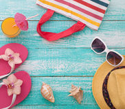 Summer vacation. Pink sandals by swimming pool Stock Photos