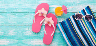 Summer vacation. Pink sandals by swimming pool Stock Images