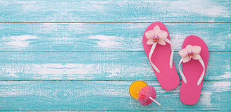 Summer vacation. Pink sandals by swimming pool. stock photos