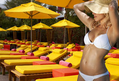 Summer Vacation Pool Girl. Girl in a white bikini visits the colorful pool area of an exclusive hotel resort Stock Photography