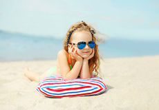 Summer vacation, relaxation, travel concept - portrait child lying resting on beach Royalty Free Stock Photography