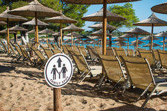 Summer vacation. Resort beach. Sun chairs on the beach with sea in background. Summer holiday / vacation. Xenia Golden Beach, Paliouri, Chalkidiki, Greece on a Stock Image