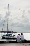 Summer vacation in the resort city. Couple in love resting on the waterfront Stock Image