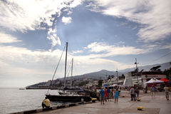 Summer vacation in the resort city. Yalta embankment on a warm summer day Stock Photos