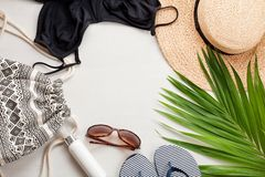 Summer vacation at the seaside concept flat lay. Beach accessories and sea shells top view Stock Photos