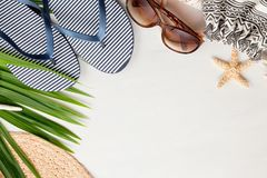 Summer vacation at the seaside concept flat lay. Beach accessories and sea shells top view Stock Images