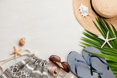 Summer vacation at the seaside concept flat lay. Beach accessories and sea shells top view Royalty Free Stock Images