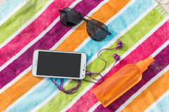 Summer vacation smartphone, sunglasses, sunscreen Royalty Free Stock Photo