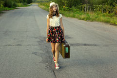 Summer vacation with a suitcase. A girl travels on foot. Stock Image