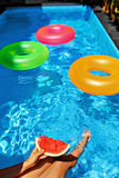 Summer Vacation. Summertime Fun. Watermelon By Swimming Pool. Fruits Royalty Free Stock Images
