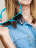 Summer vacation. Sunglasses in female hand Royalty Free Stock Images