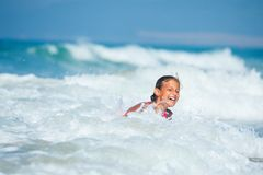 Summer vacation - surfer girl. Summer vacation - Happy cute girl having fun with surfboard in the ocean Stock Photos