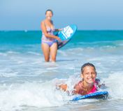 Summer vacation - surfer girls. Stock Images