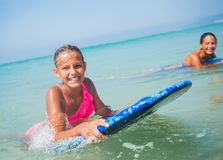 Summer vacation - surfer girls. Stock Image