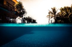 Summer vacation swimming pool background in vintage style with water level turquoise water as travel holidays lifestyle. Background stock image