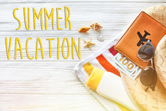 Summer vacation text concept flat lay. colorful towel, hat, pass Stock Photos