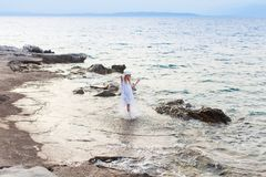 Summer vacation to the sea, woman walking on the beach royalty free stock images