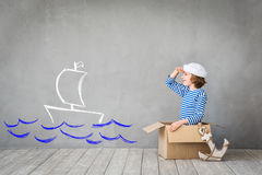 Summer vacation and travel concept. Child pretend to be sailor. Kid having fun at home. Summer vacation and travel concept Stock Photos