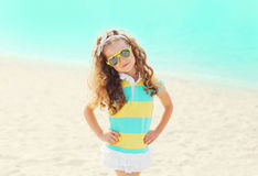 Summer vacation, travel concept - little girl child on beach wearing a sunglasses Royalty Free Stock Photography