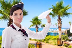 Summer, vacation and travel concept - stewardess with paper plan Royalty Free Stock Photo