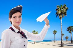 Summer, vacation and travel concept - stewardess with paper plan Royalty Free Stock Photography