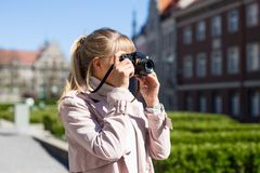 Summer vacation and travel concept - woman taking photos of old town royalty free stock photography