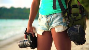 Summer vacation, travel and lifestyle concept: carefree woman with camera enjoy sunset over tropical beach. Summer vacation, travel and lifestyle concept: young stock video