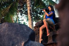 Travel woman photographer takes photos nature landscape on camera outdoor. Summer vacation, Travel and LifeStyle concept Stock Images