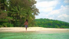 Summer vacation, travel and lifestyle concept: happy couple on the tropical beach. Summer vacation, travel and lifestyle concept: young interracial couple white stock footage