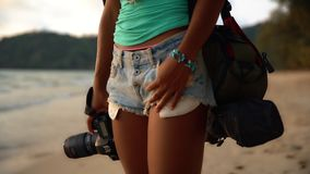 Summer vacation, travel and lifestyle concept: carefree woman with camera enjoy sunset over tropical beach. Summer vacation, travel and lifestyle concept: young stock footage