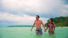 Slow motion video: happy interracial couple on the tropical beach. Summer vacation, Travel and LifeStyle concept. Summer vacation, Travel and LifeStyle concept stock footage