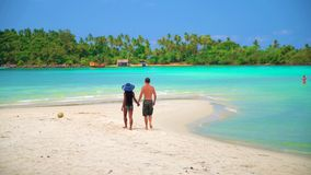 Summer vacation, Travel and LifeStyle concept: Happy couple on the tropical beach. Summer vacation, Travel and LifeStyle concept: Young Interracial couple white stock video