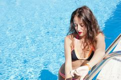 Summer vacation and travel to maldives. Miami beach is sunny. Swag. caribbean sea. Dope. Spa in pool. girl with red lips and. Wet hair. woman in swimming pool royalty free stock images