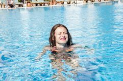 Summer vacation and travel to maldives. woman in swimming pool. Miami beach is sunny. Swag. caribbean sea. Dope. Spa in pool. Girl with red lips and wet hair royalty free stock photos