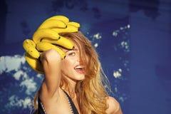 Summer vacation and travel to ocean. Vitamin in banana at girl near water. Dieting and healthy organic food, vegetarian royalty free stock image