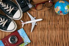 Summer vacation, travel, tourism and objects concept. Passport travel document photo camera sunglasses globe map, top view. Summer vacation, travel, tourism and Stock Photos