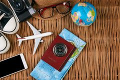 Summer vacation, travel, tourism and objects concept. Passport travel document photo camera sunglasses globe map, top view. Summer vacation, travel, tourism and Royalty Free Stock Image