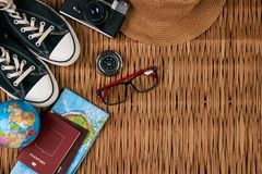 Summer vacation, travel, tourism and objects concept. Passport travel document photo camera sunglasses globe map, top view. Traveler items vacation travel Stock Photography