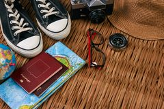 Summer vacation, travel, tourism and objects concept. Passport travel document photo camera sunglasses globe map, top view. Traveler items vacation travel Royalty Free Stock Photo